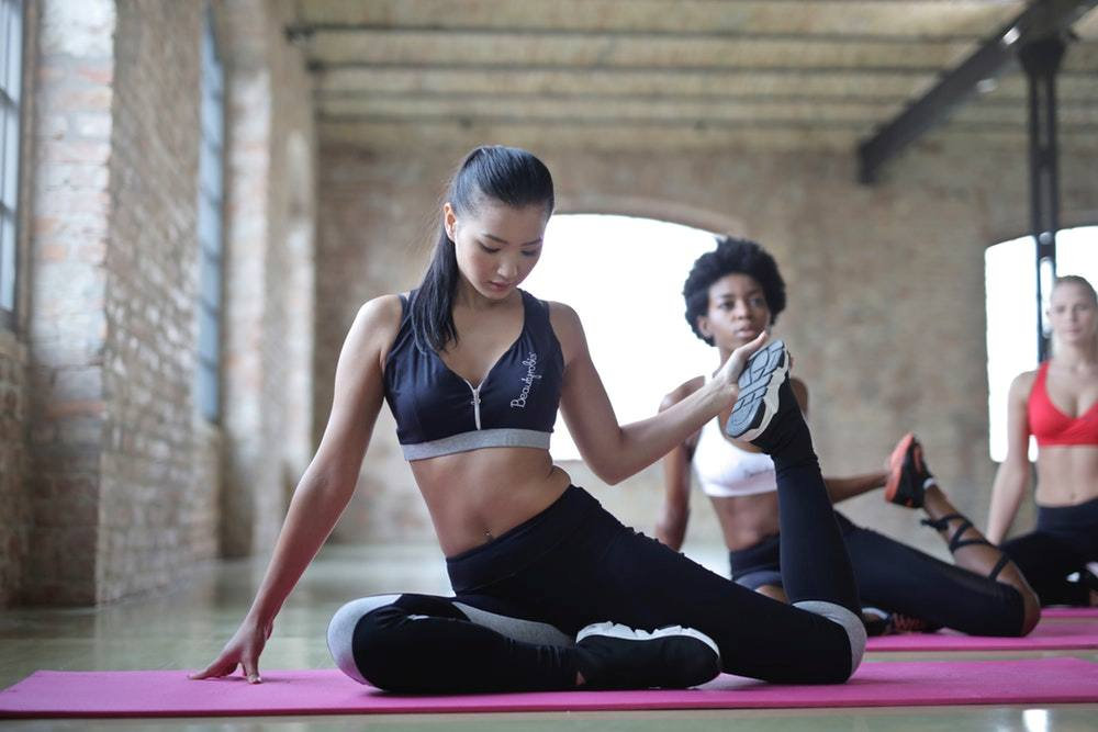 women doing yoga warm up exercises